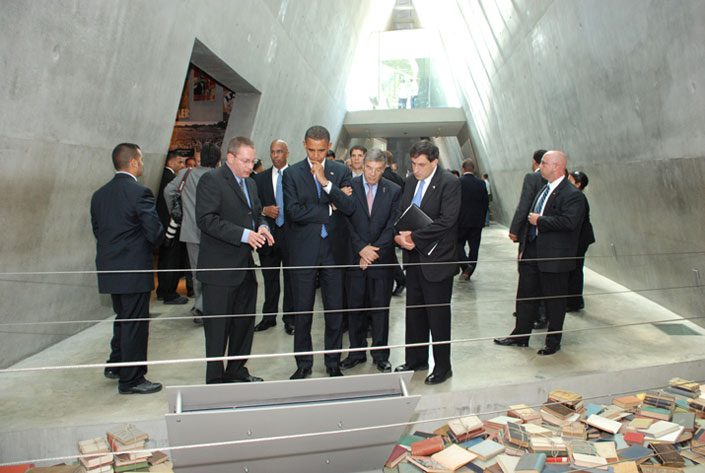 Senator Barack Obama studies an exhibit in the Holocaust History Museum; to his right is Israel's Ambassador to the United States Sallai Meridor