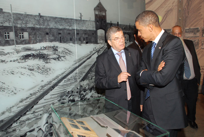 Senator Obama, accompanied by Chairman of the Yad Vashem Directorate Avner Shalev, views the Auschwitz Album in the Holocaust History Museum