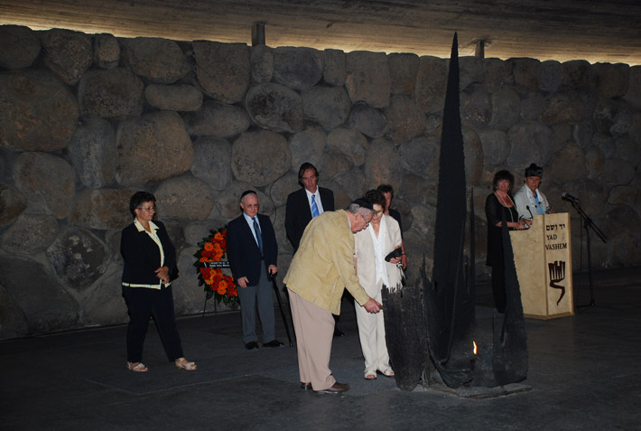 The grandchildren of Righteous Among the Nations Louise Roger rekindling the eternal flame in the Hall of Remembrance
