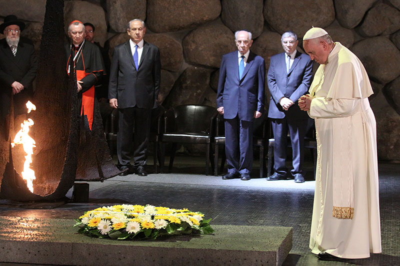 Pope Francis during a moment of silence in the Hall of Remembrance
