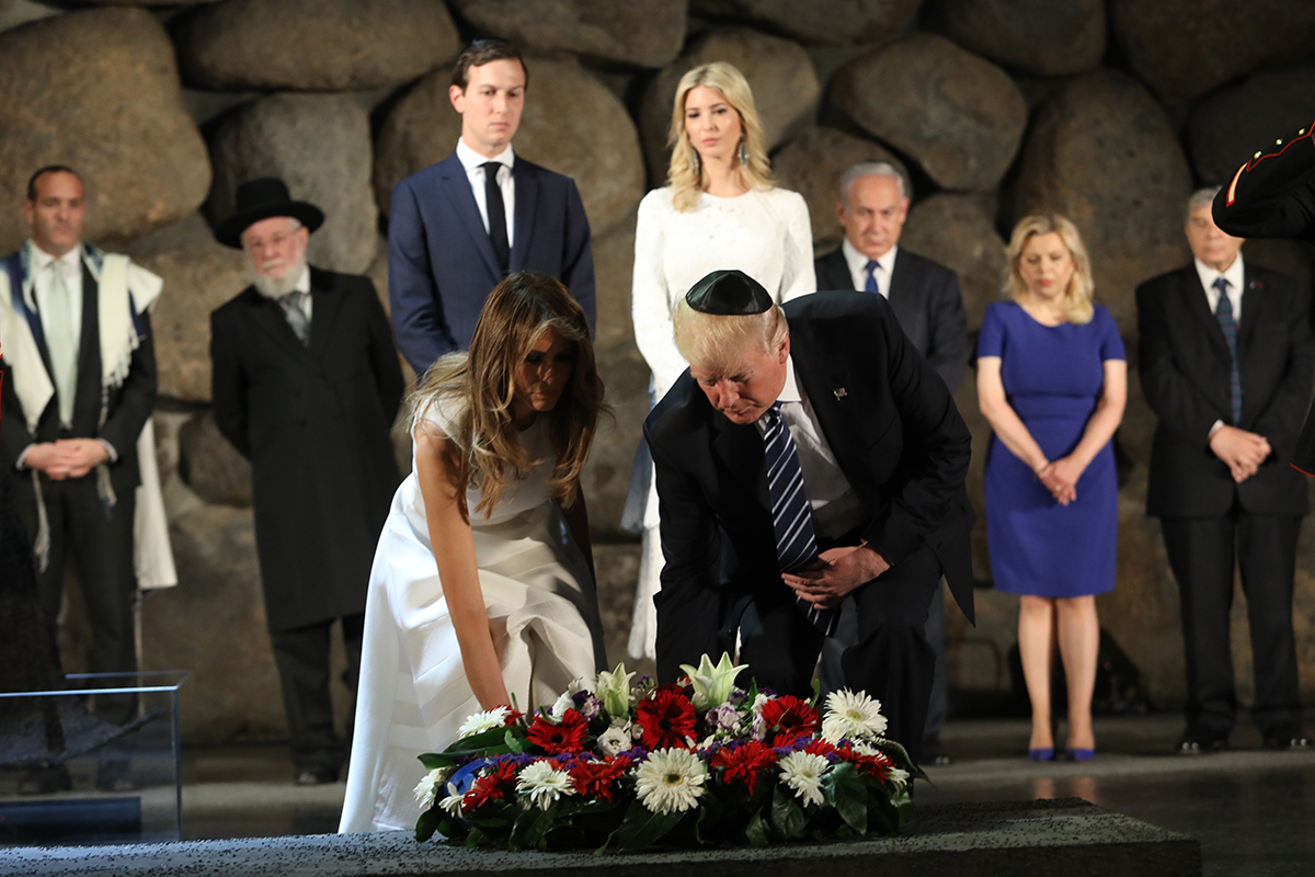 US President Donald Trump and First Lady Melania Trump laying a wreath in the Hall of Remembrance. Also pictured: Cantor Shai Abramson, Rabbi Israel Meir Lau, Jared Kushner, Ivanka Trump, Prime Minister Benjamin Netanyahu and his wife Sara, Avner Shalev
