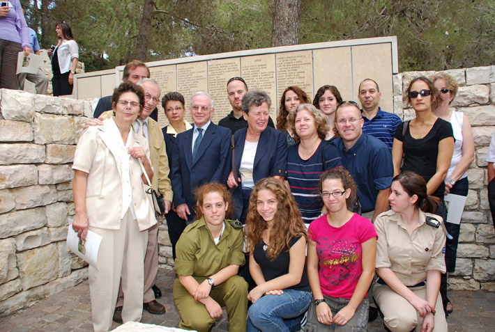 The family of survivor Ehud Loeb with the grandchildren of his rescuer, Louise Roger at the wall of honor in Garden of the Righteous