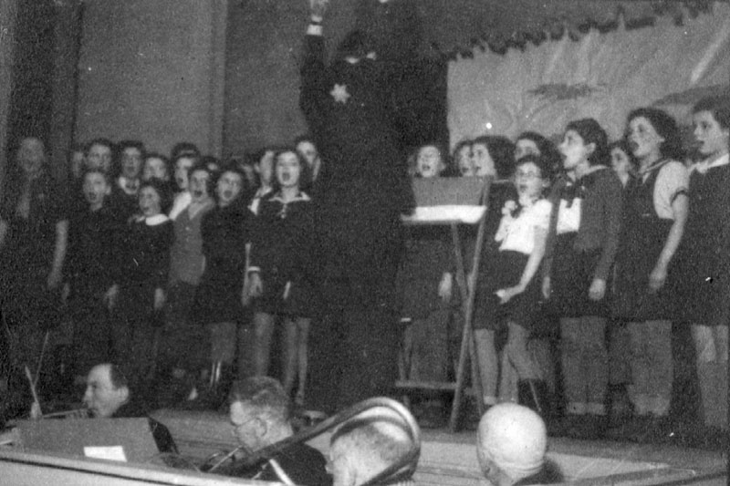 Lodz, Poland. A conductor and children's choir during a performance in the ghetto.