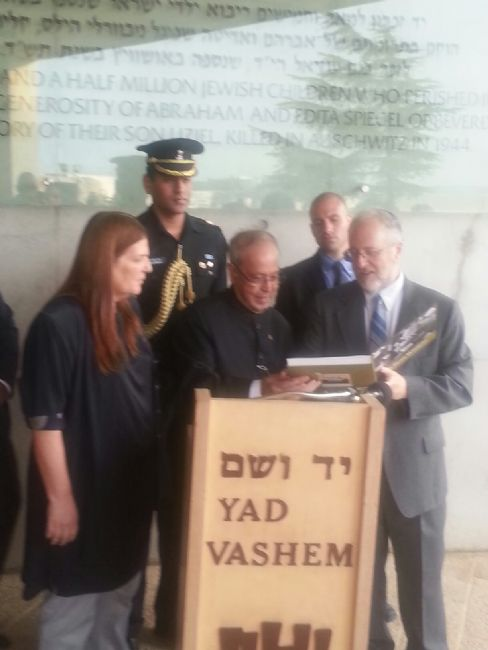 "President Mukherjee was presented with a copy of the Yad Vashem Album, ""To Bear Witness"""