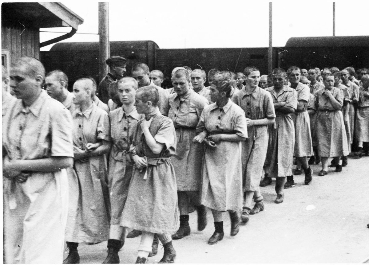 Jewish female inmates marching in the women's camp in prison clothes. Birkenau. May 27, 1944 (Photo 25)