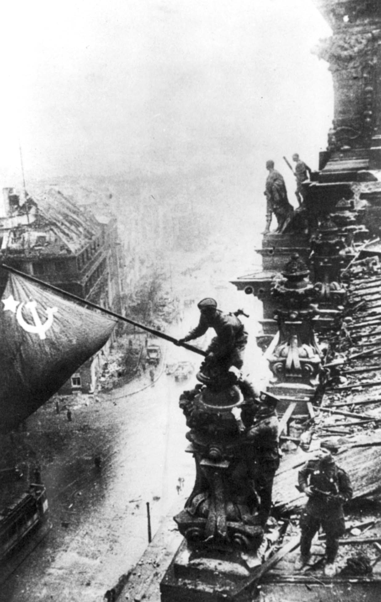 Red Army Soldier raising the flag over the ruined Reichstag, May 1945
