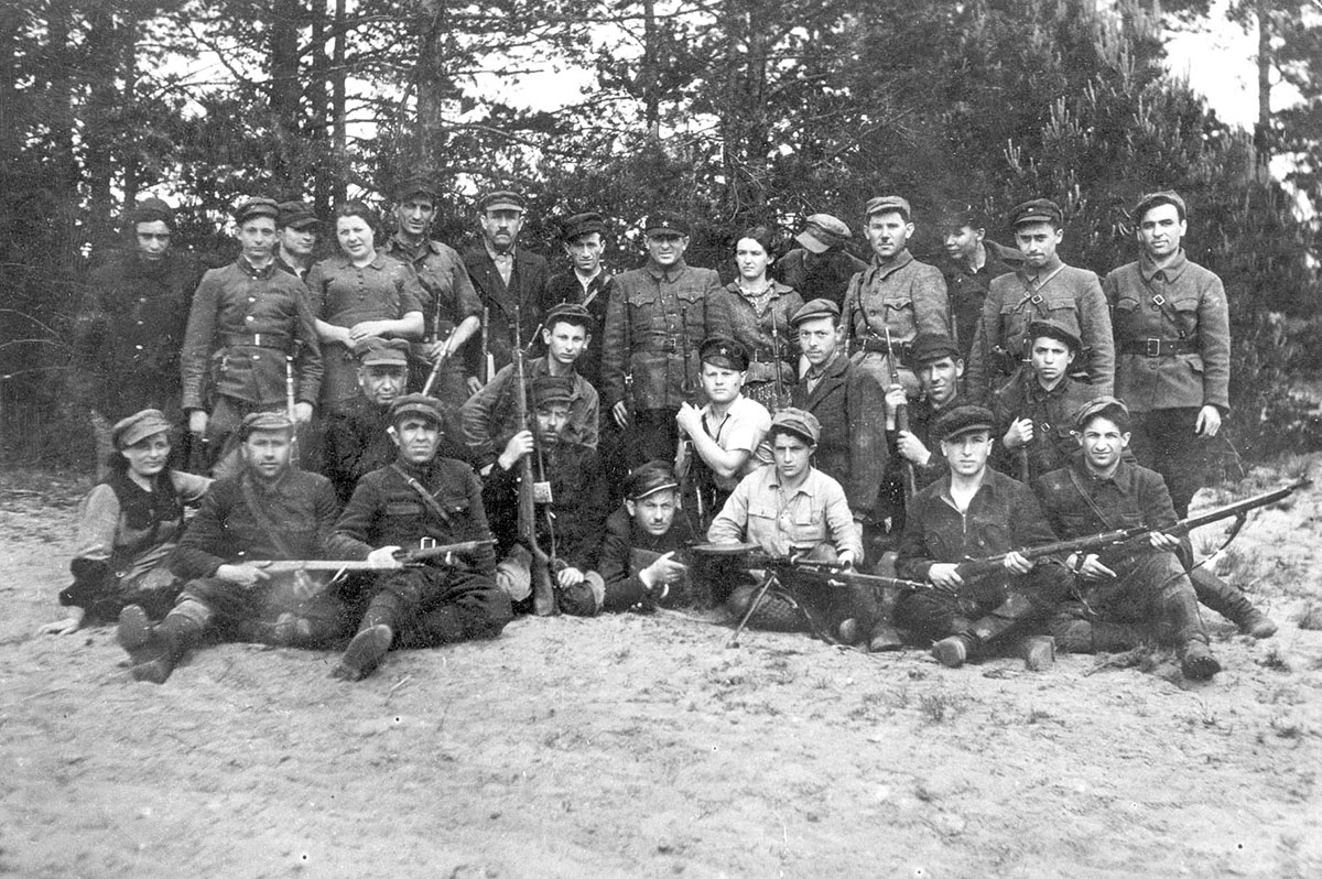 A group of partisans from different brigades guarding the airstrip in the Naliboki forest, July 1944