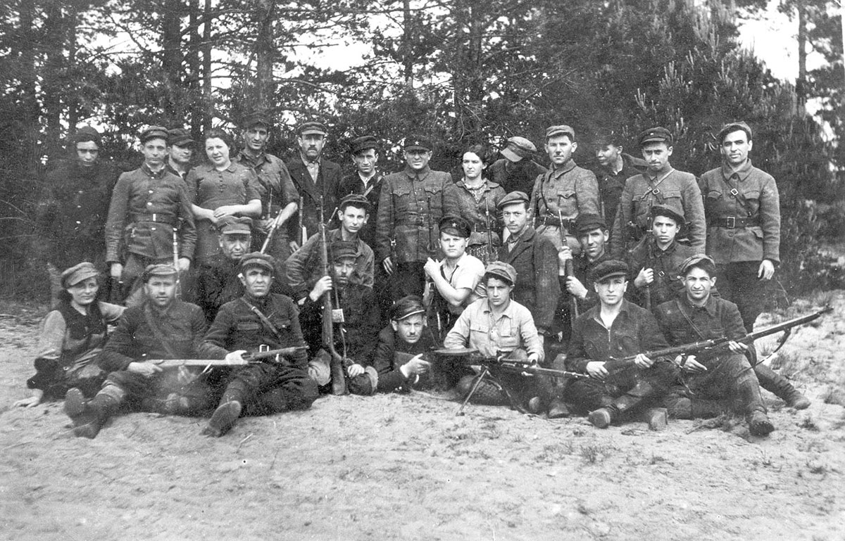Partisans guarding an airfield in the Naliboki forest, July 1944. Some of the partisans rescued Jews from the forests and protected them from the Germans