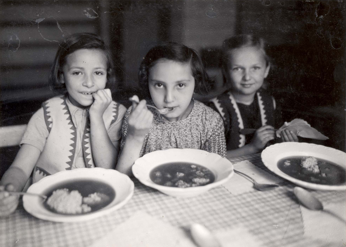 Warsaw, Poland, Girls eating at a public kitchen in the ghetto