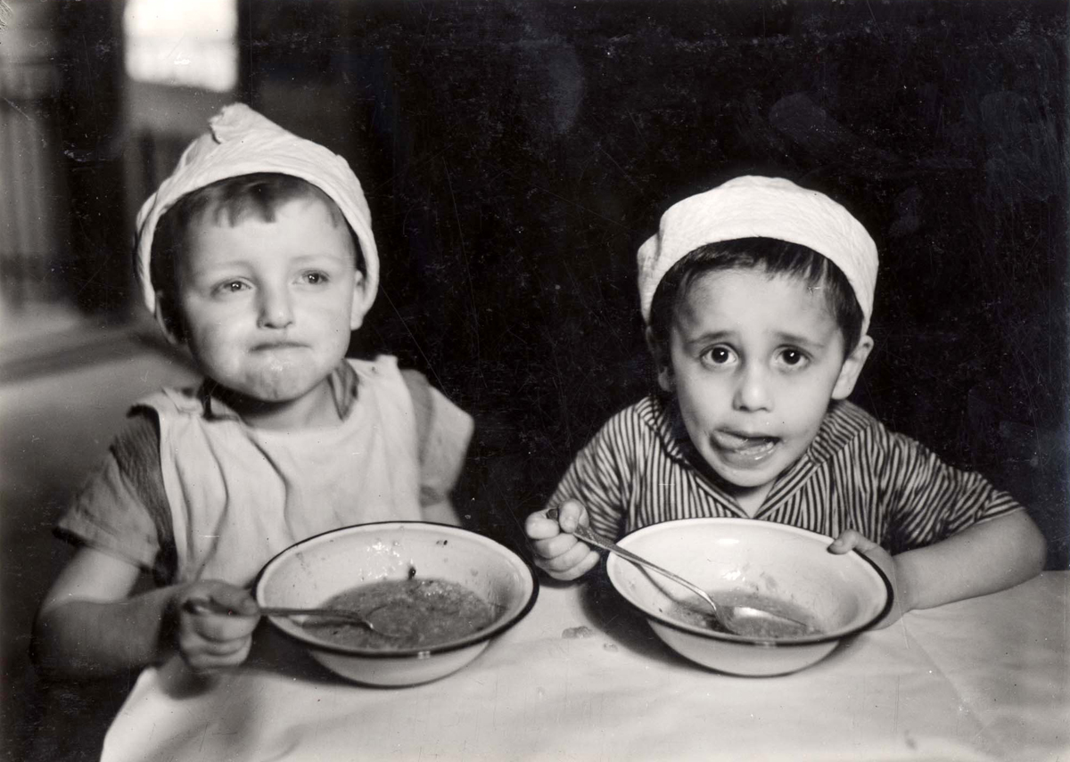 Warsaw, Poland, Two children eating in an orphanage on Twarda St. 21 in the ghetto