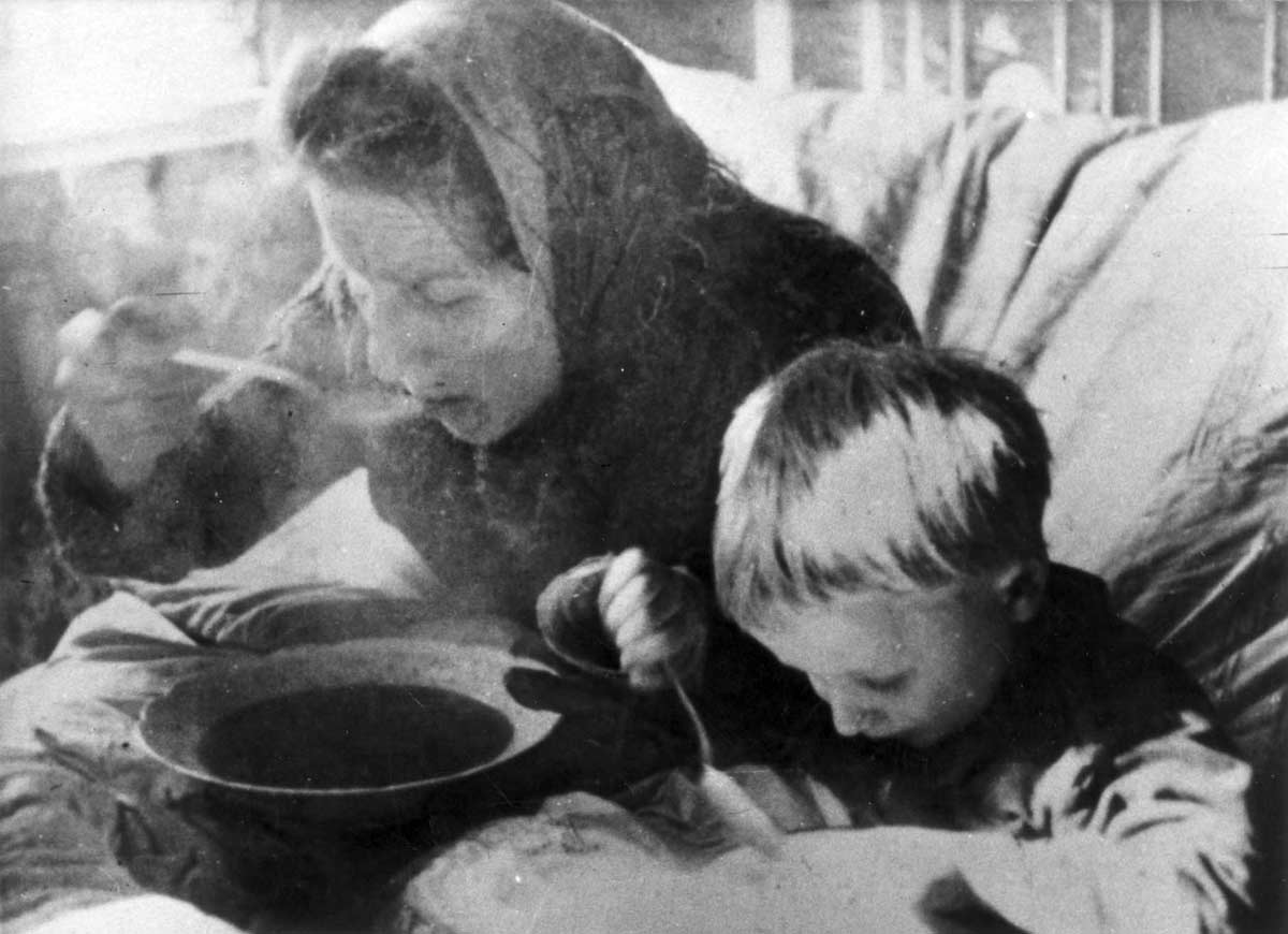 Lodz, Poland, Fiega Freitag and her son Jakov Freitag eating soup.