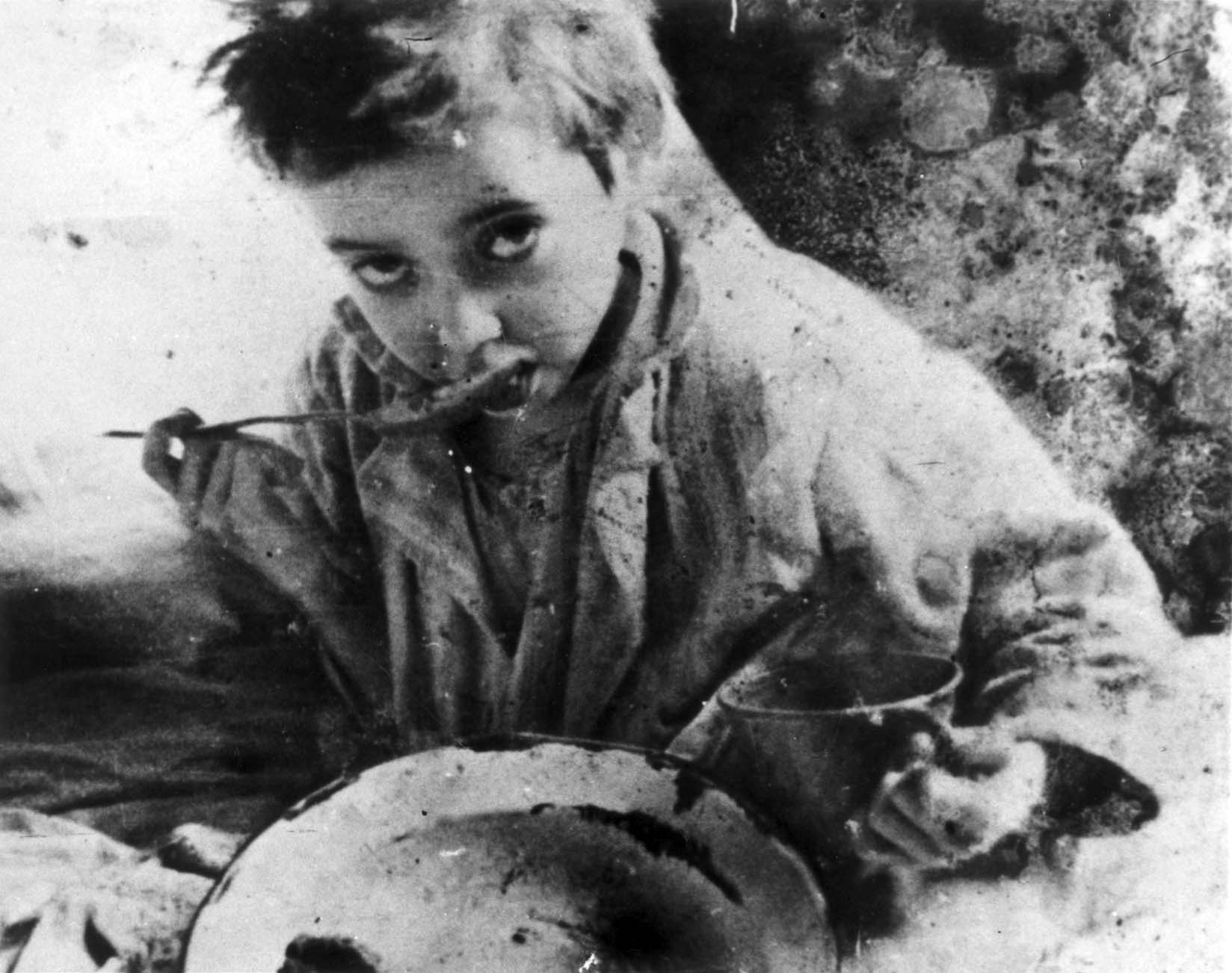 Child eating soup in the Lodz Ghetto