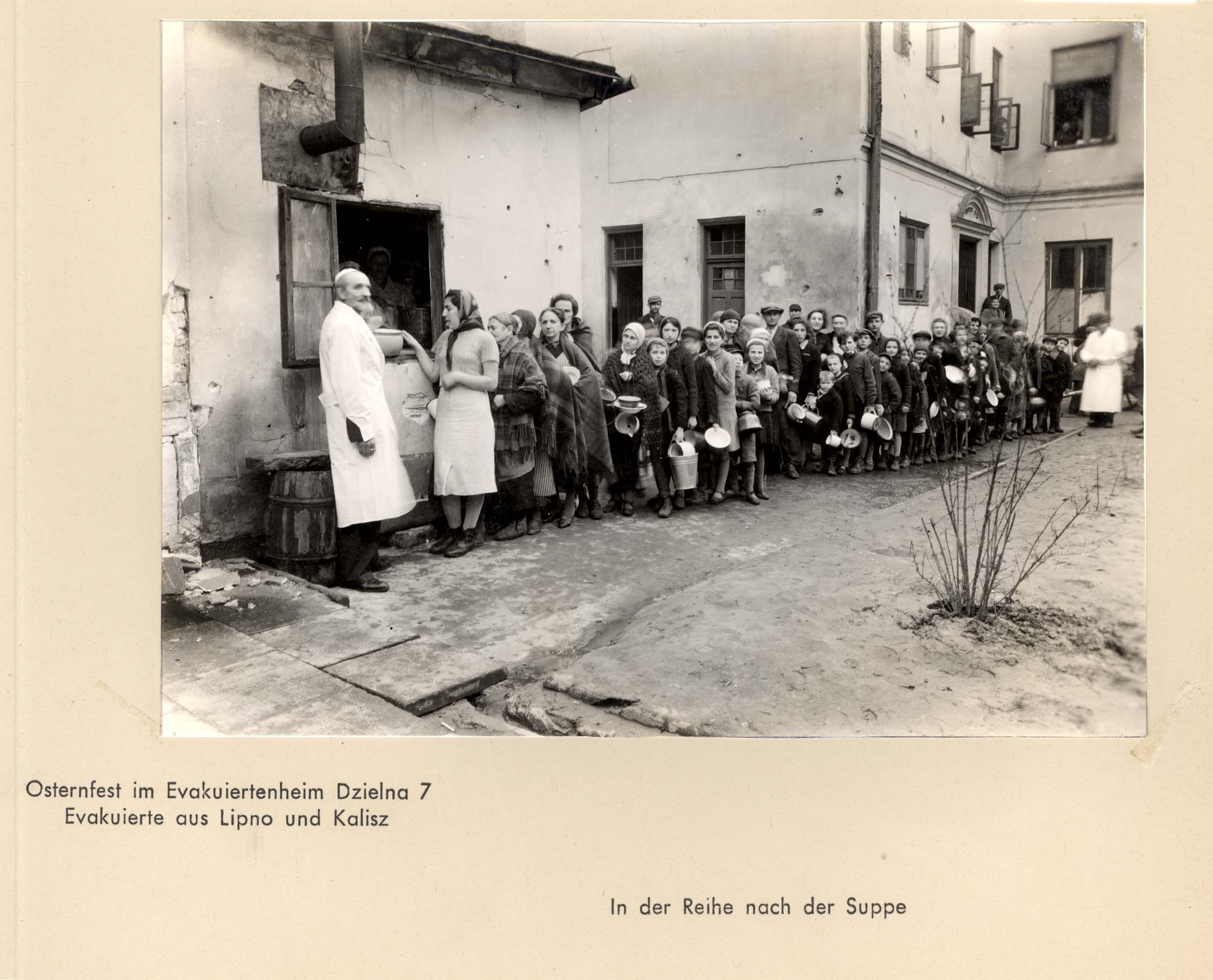 Warsaw, Poland, People lined up at a public kitchen in the ghetto