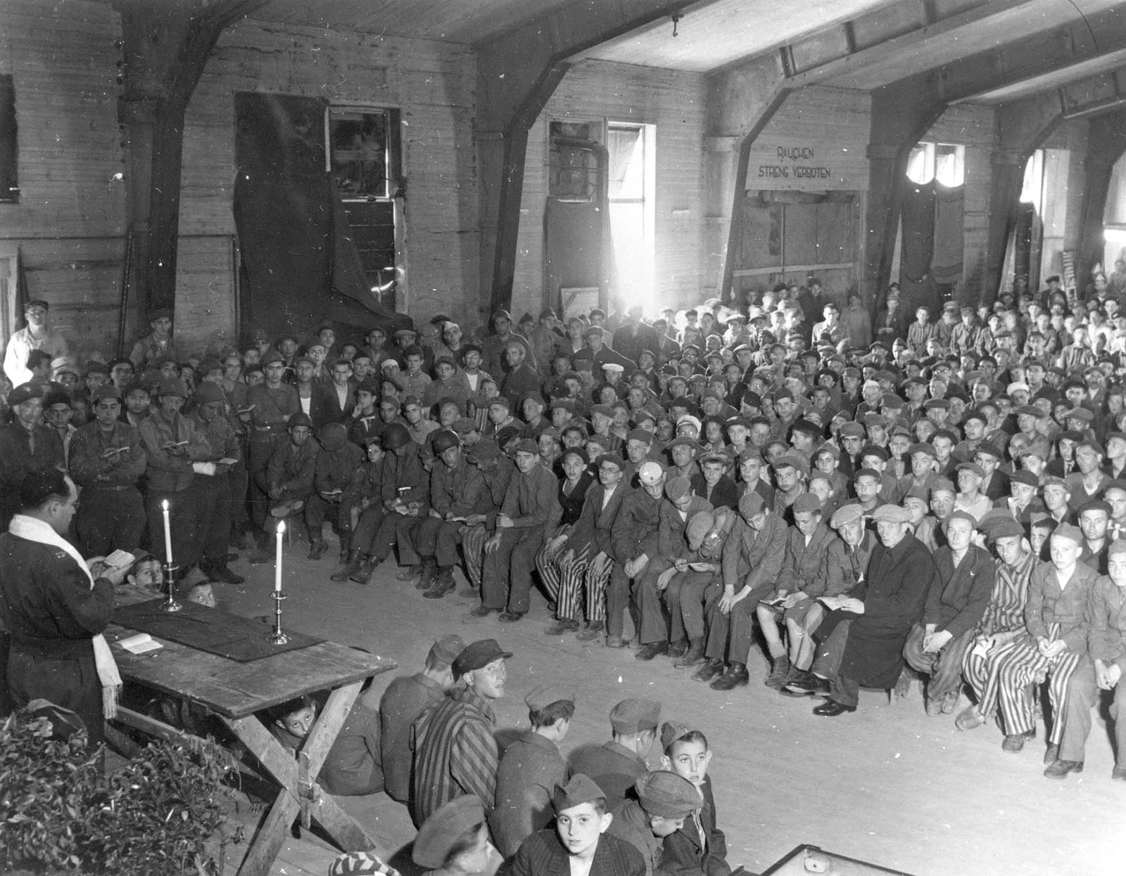 Rabbi Herschel Schacter leading the Shavuot prayer service for survivors in the Buchenwald camp in Germany in 1945