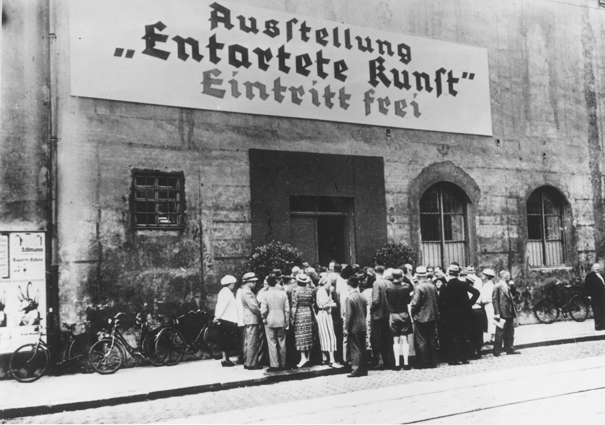 Munich, Germany, A crowd at the entrance to an exhibit entitled, Degenerate Art, 1937
