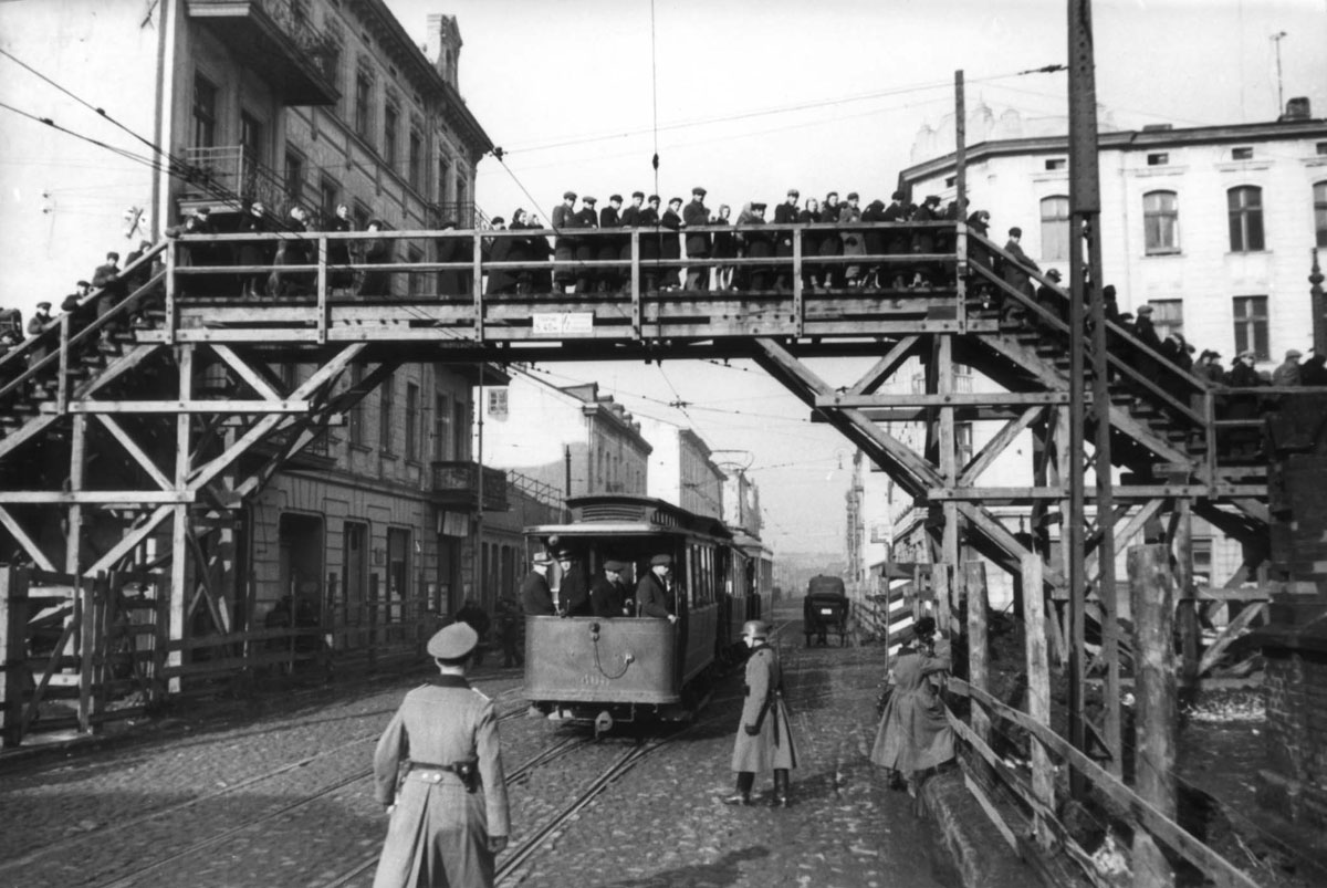 Jews on the bridge that connected two sections of the Lodz Ghetto, Poland, February 1941