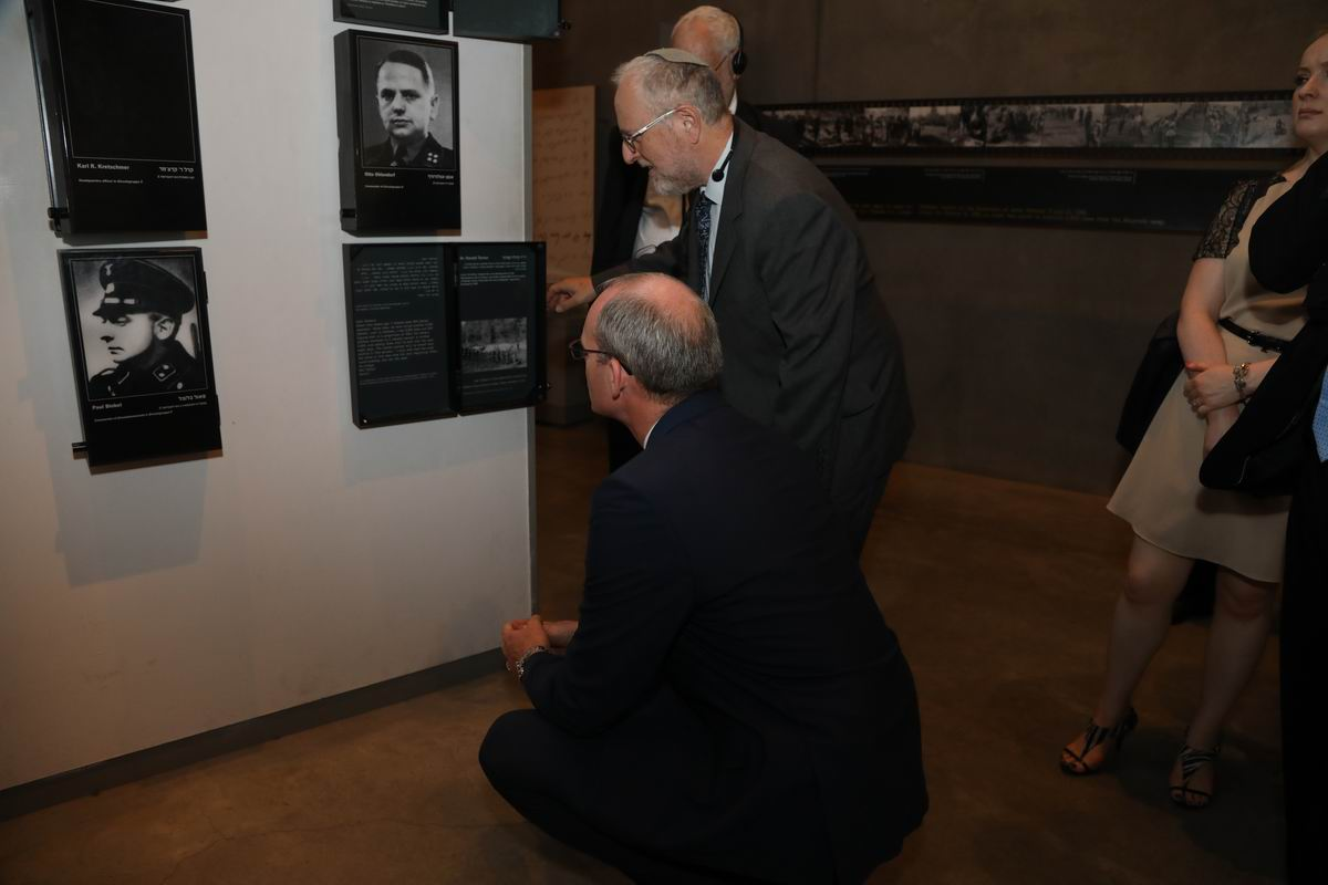 Foreign Minister Simon Coveney (front) inspects exhibits on Nazi war criminals in Yad Vashem's Holocaust History Museum