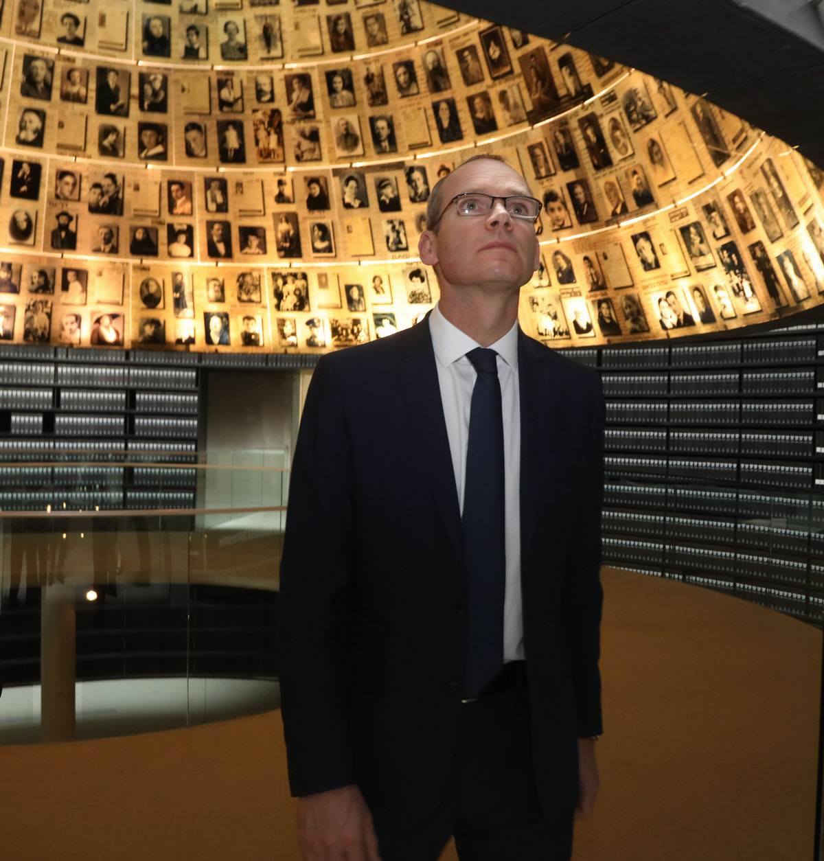 The Irish Foreign Minister toured the Hall of Names – a symbolic tombstone to the six million Jewish men, women and children murdered during the Shoah