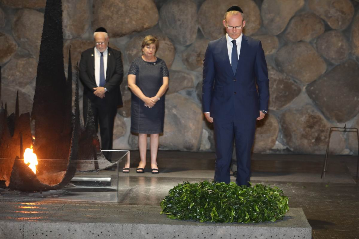 Ireland's Minister of Foreign Affairs and Trade laid a commemorative wreath in the Hall of Remembrance. (Background: Ireland's Ambassador to Israel H.E. Ms. Alison Kelly and Israel's Ambassador to Ireland H.E. Mr. Ze'ev Boker)
