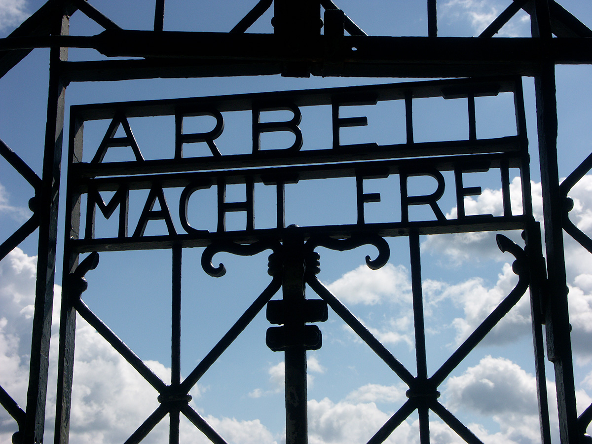 Detail of the main gate at Dachau concentration camp in Germany, displaying the