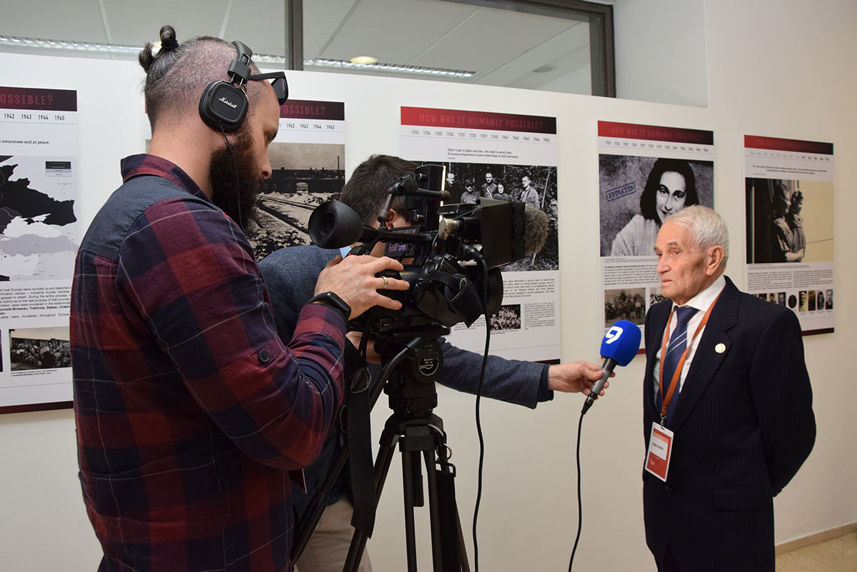 Holocaust survivor Felix Sorin being interviewed by the press prior to the beginning of Fifth World Holocaust Forum 2020