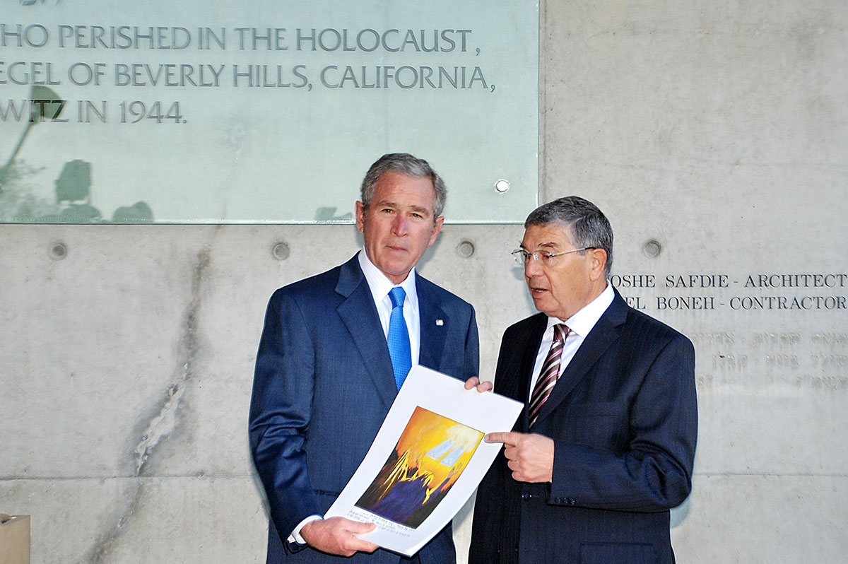 President Bush receiving the first copy of Carol Deutsch's Illustrated Bible from Chairman of the Yad Vashem Directorate Avner Shalev outside of the Children's Memorial