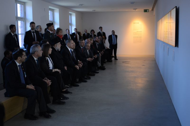 Prime Minister Netanyahu, Government Ministers and Yad Vashem Chairman and exhibition curator Avner Shalev watch Holocaust survivor testimonies at the exhibition
