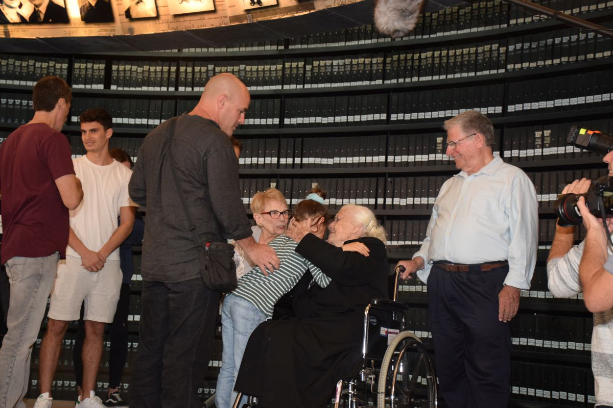 Holocaust survivors and their family meet Righteous Among the Nations Melpomeni Dina at Yad Vashem's Hall of Names