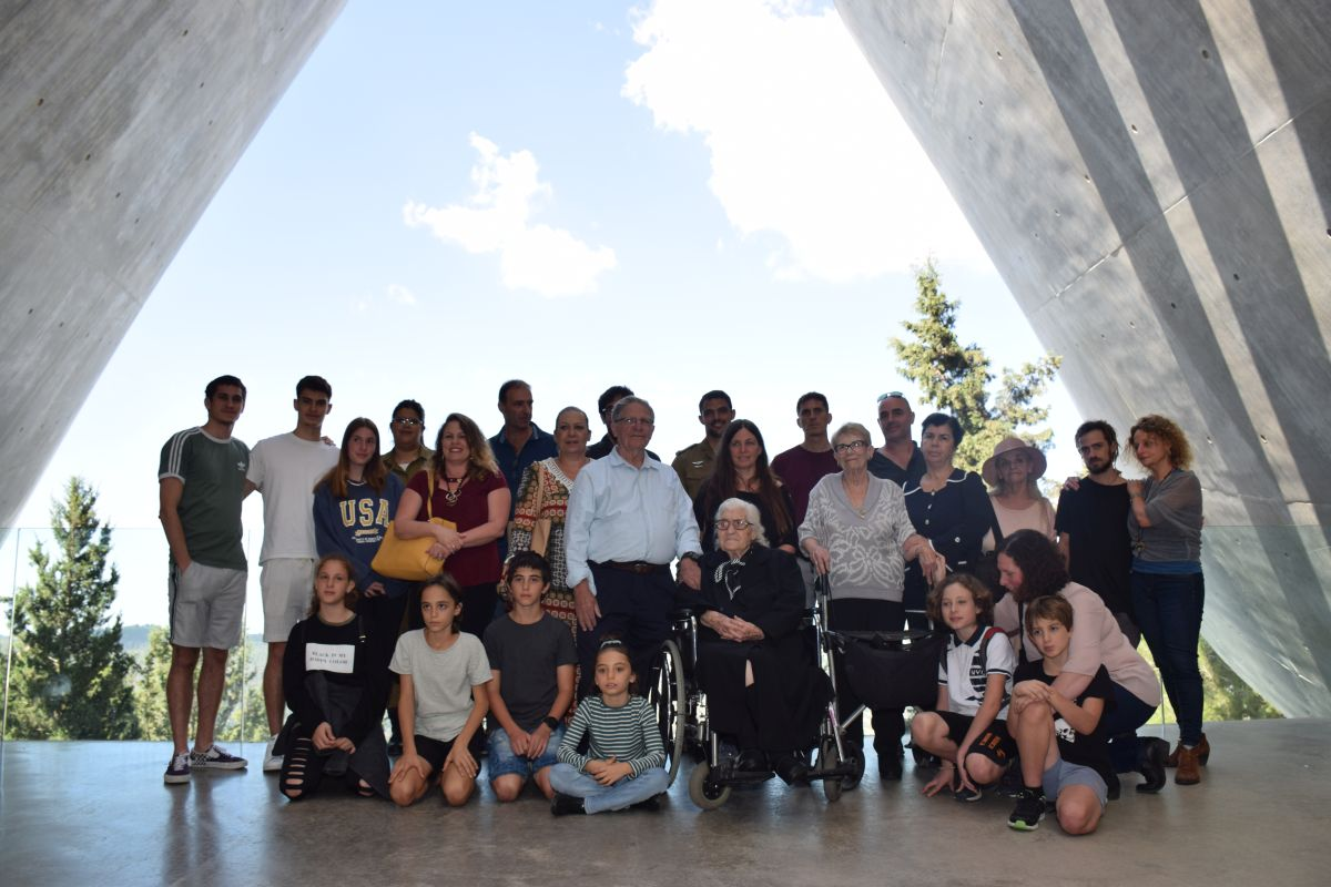Descendants of the Mordechai family and Righteous Among the Nations rescuer Melpomeni Dina on the balcony exiting from Yad Vashem's Holocaust History Museum