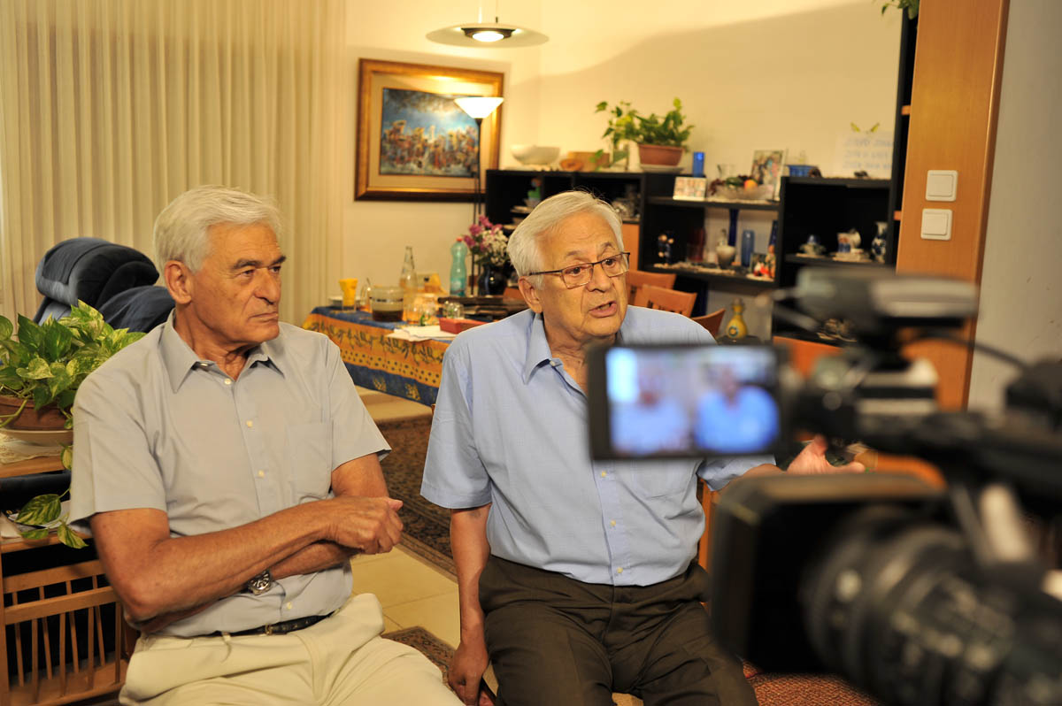Brothers Eli (left) and Dan Steiner, Holocaust survivors from Zagreb, Yugoslavia (today Croatia), being interviewed by Nava Gibori and filmed by Yifat Barkan in Dan's home in Haifa, Israel, August 2017