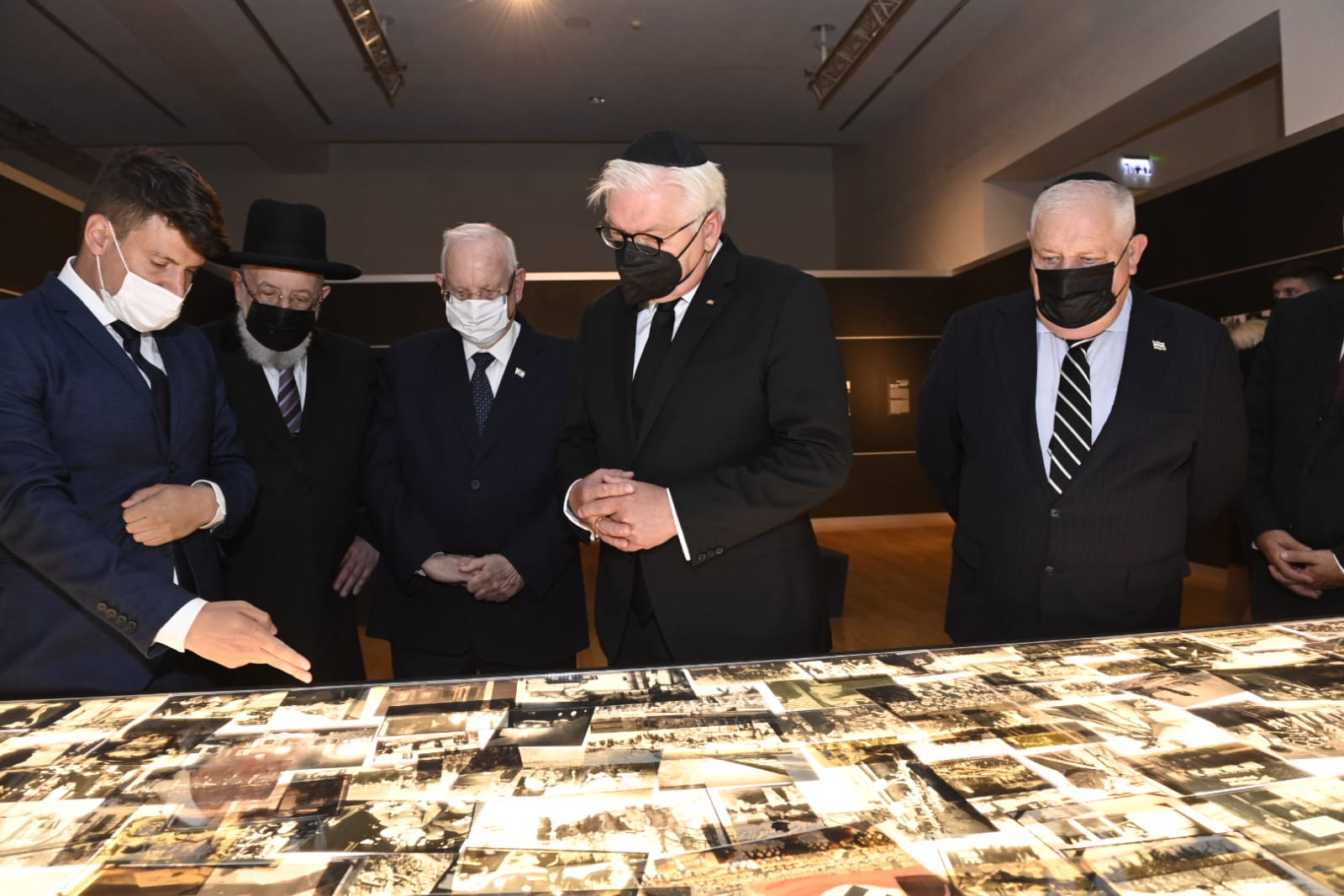 """(L-R) Yad Vashem Council Chairman Israel Meir Lau, President of Israel Reuven Rivlin, President of Germany Frank-Walter Steinmeier and Acting Yad Vashem Chairman Ronen Plot tour the """"Flashes of Memory: Photography during the Holocaust"""" exhibition"""