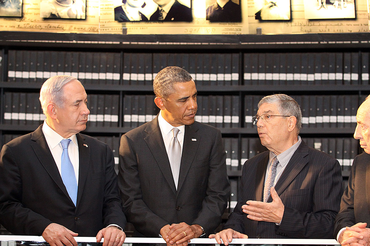 President Barack Obama listens to an explanation in the Hall of Names by Chairman of the Yad Vashem Directorate Mr. Avner Shalev