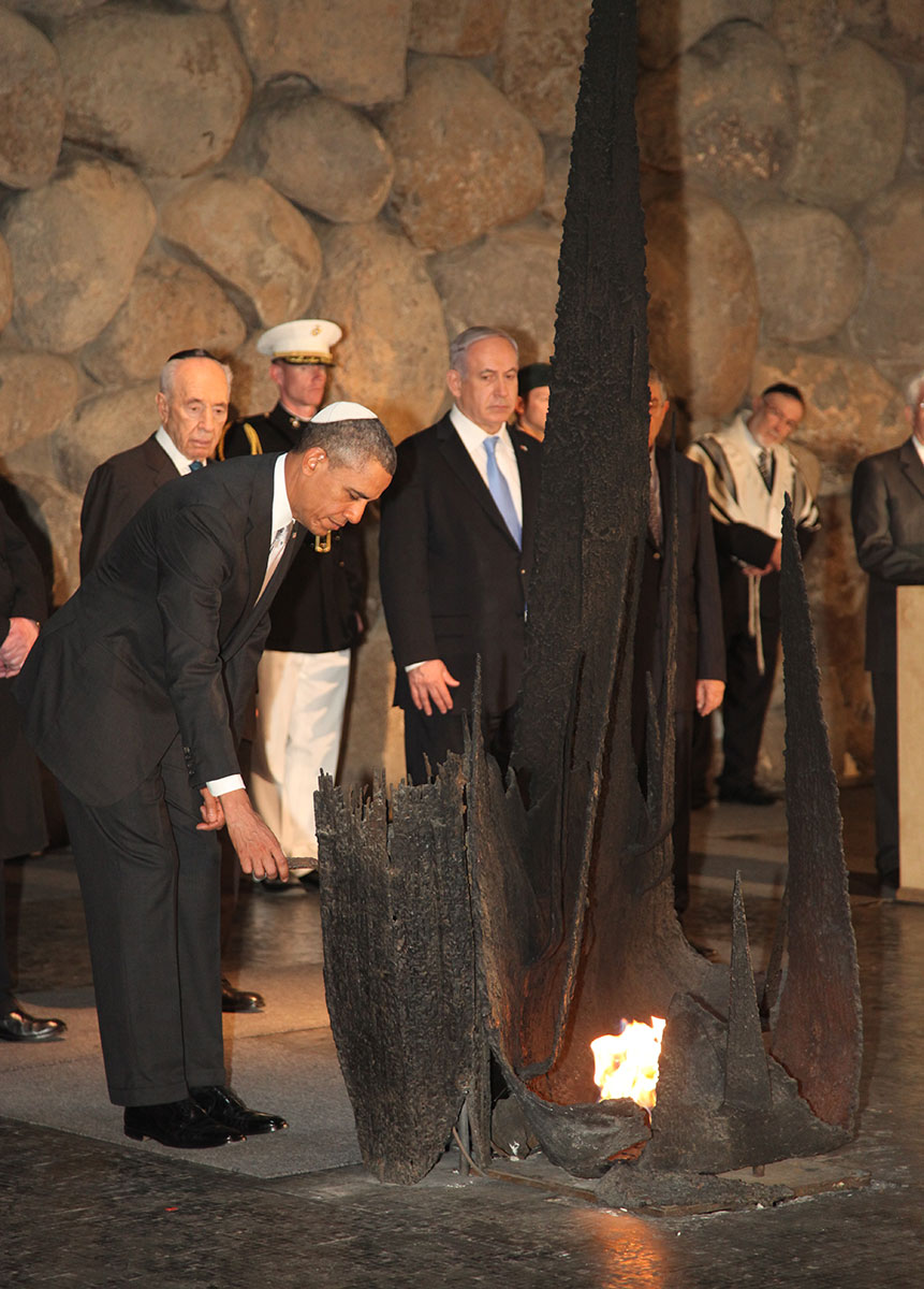 President Barack Obama lighting the flame in the Hall of Remembrance