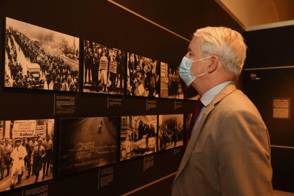 Canadian Foreign Minister Marc Garneau tours the Flashes of Memory exhibition at Yad Vashem
