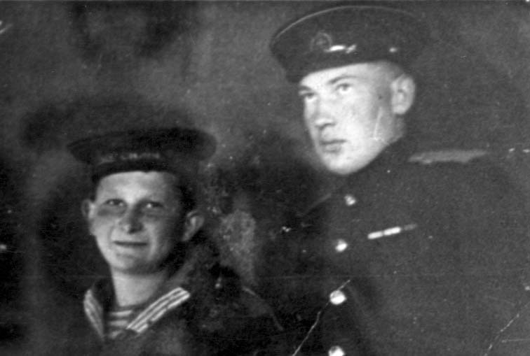 "Mikhail Aizengart, ""a son of the regiment,"" with his petty officer in the Northern Baltic Fleet Air Force, [1943?]"