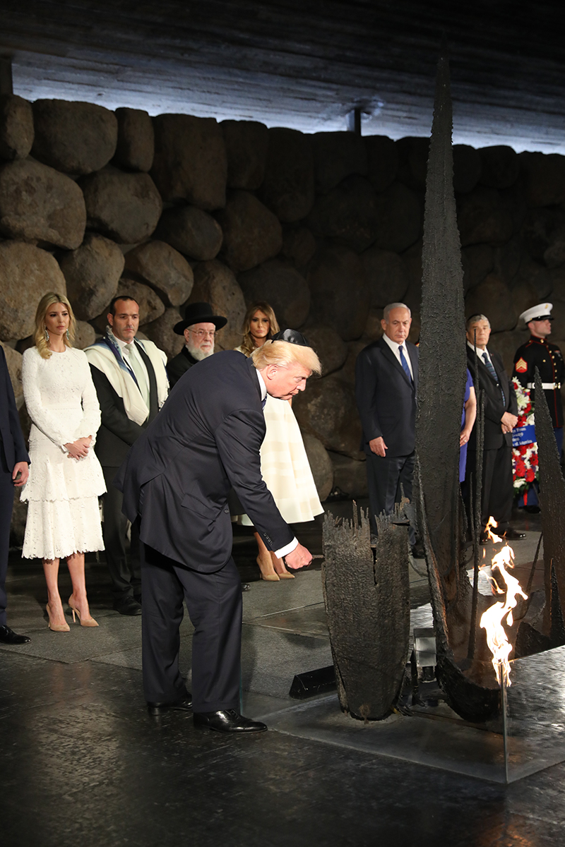 President Donald J. Trump rekindles the eternal flame in the Hall of Remembrance at Yad Vashem