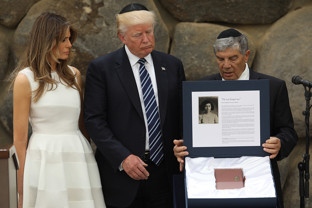 Yad Vashem Chairman Avner Shalev presents United States President Donald J. Trump and First Lady Melania Trump with a replica of a Holocaust-era album.