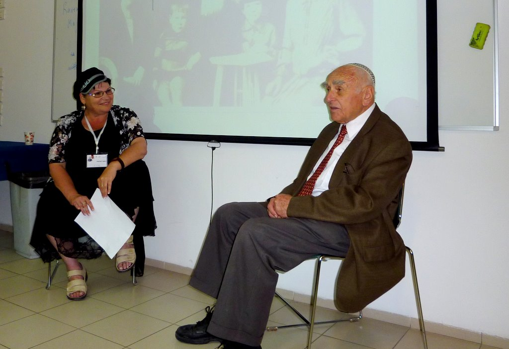 Yad Vashem's Shulamit Imber and child Holocaust survivor David Zucker