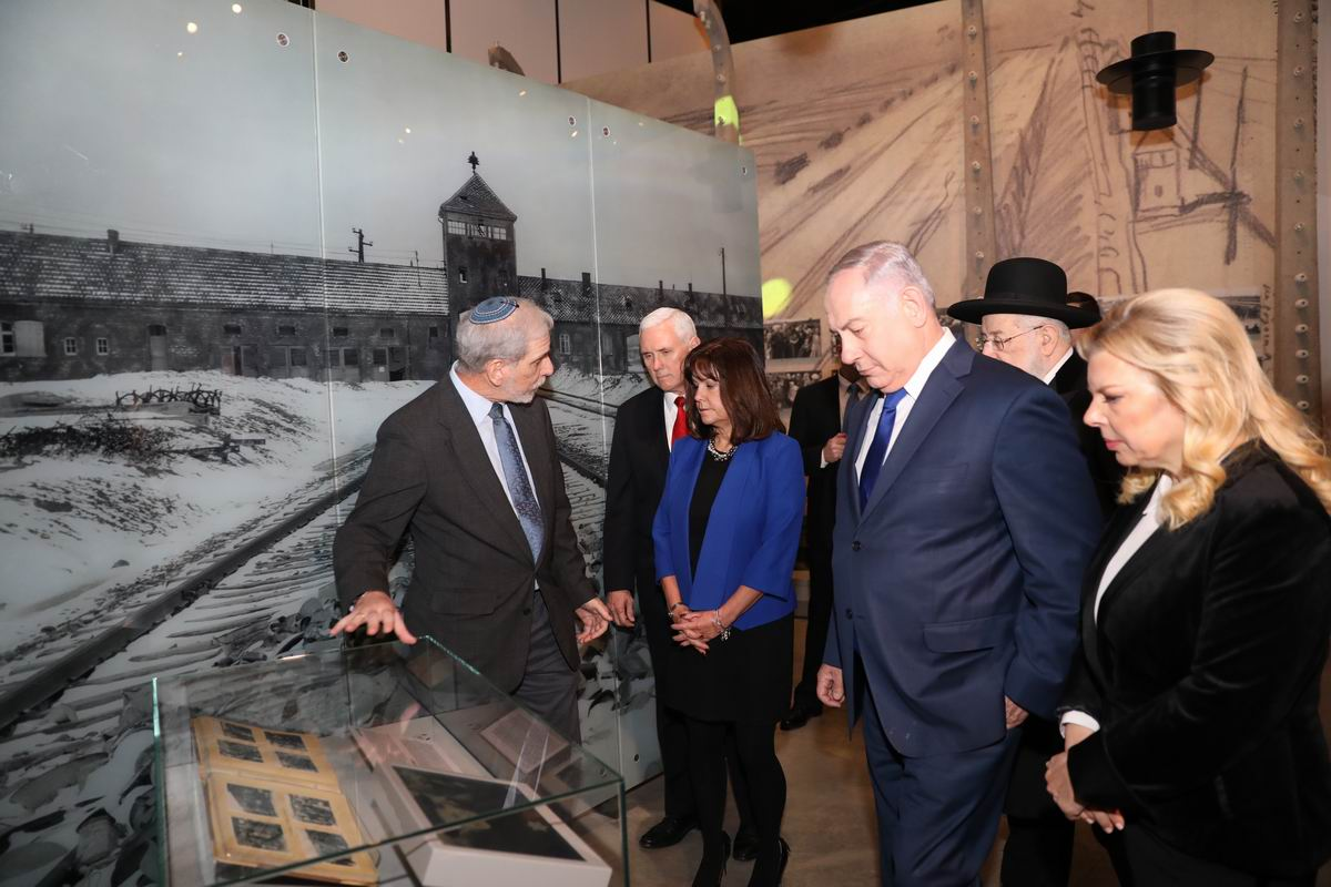 "The Vice President and Second Lady viewing ""The Auschwitz Album,"" which documents the selection process at the death camp"