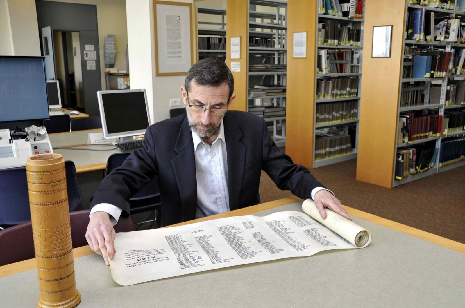 Alexander Avram examines the scroll of names
