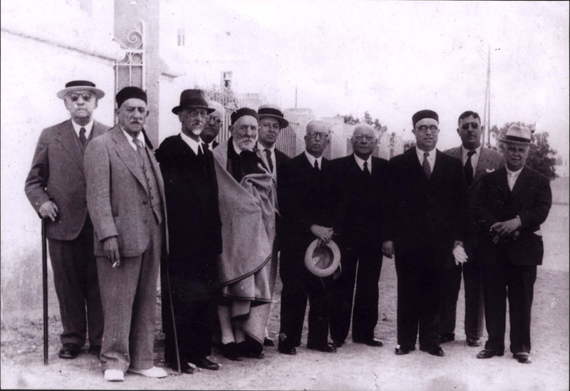Tunis, Tunisia, Rabbi Cheim Baleish (fifth from left), the Chief Rabbi of Tunisia with members of the Jewish council, 1942- 1943.