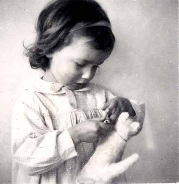 A girl with a doll at a children's home in France