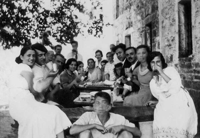 Ioannina, Greece, late 1930s. A social meeting at a house's courtyard in town.