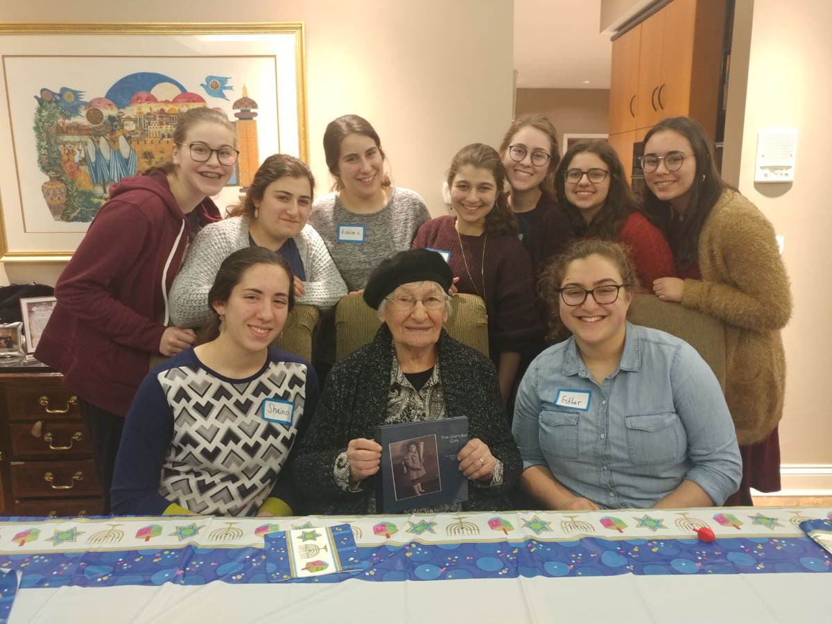 Holocaust survivor Naomi Jacobson with students from the Lubavitch Girls High School in Chicago