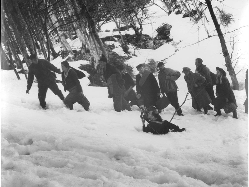 Austria. 'Bericha' activist Meir Levin filming survivors passing covertly in the snow on their way to Italy after the war