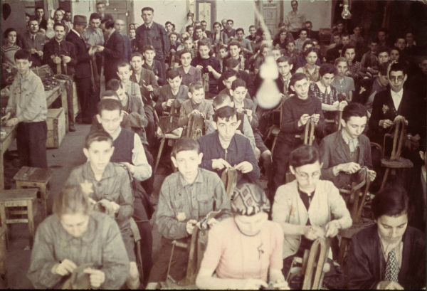 Workers in a saddle factory in the Lodz ghetto