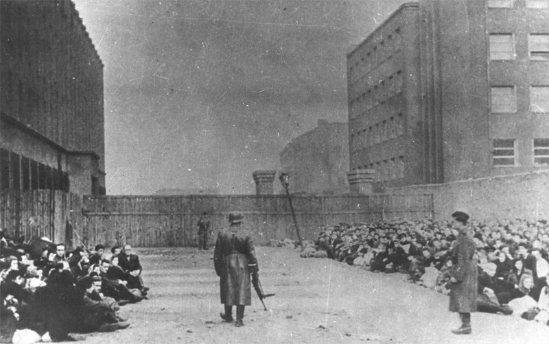Jews at the Warsaw Umschlagplatz, where they were assembled before being deported to the death camp. 1943.