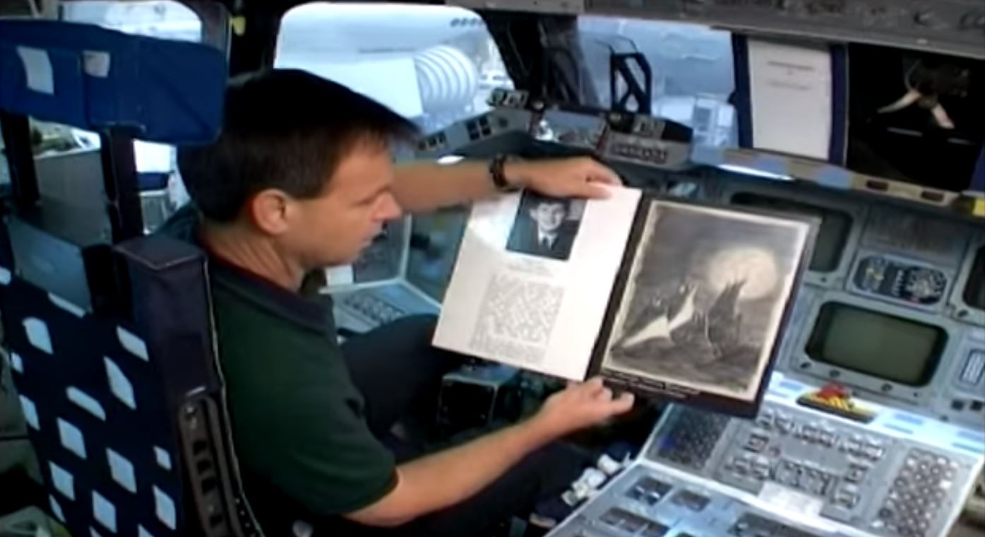"The late Israeli Astronaut Ilan Ramon with his copy of ""Moon Landscape"" which he took to space aboard the ""Columbia"" in 2003"