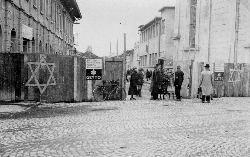 A Hungarian gendarme checks a woman entering the Munkács ghetto
