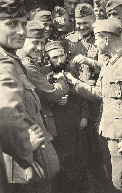 Poland, Wehrmacht soldiers cutting a Jew's beard.